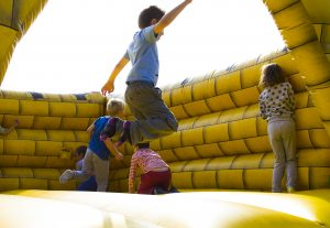 Kids enjoying bouncy castle rental